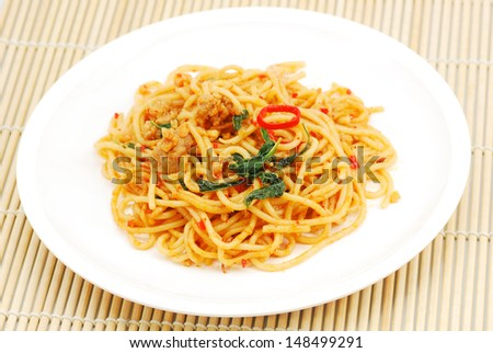 Thai spicy fried noodle with pork  - stock photo