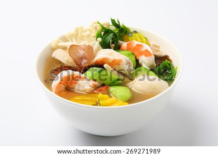 Thai Spicy Mixed Vegetable Soup with Prawns (Kang Liang Goong Sod) - stock photo