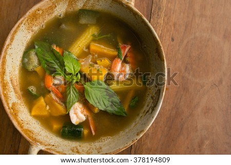 Thai Spicy Mixed Vegetable Soup with Prawns - street food asian style - stock photo