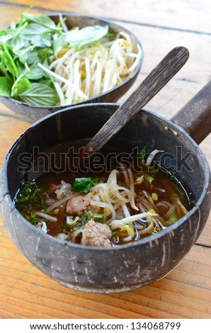Thai spicy noodle in coconut shell - stock photo