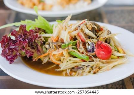 Thai spicy papaya salad serve with vegetables - stock photo