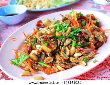 thai spicy salad with grilled pork and fish