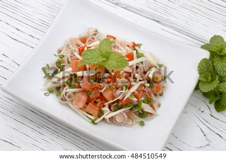 thai spicy salmon salad on wood table, thai food