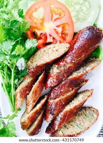 Thai spicy sausage Asgaew with fresh vegetables - stock photo