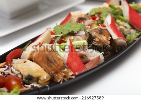 Thai spicy seafood salad on the plate