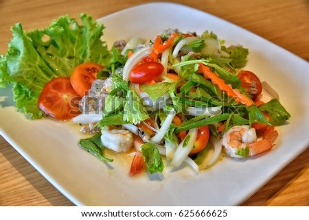Thai Spicy Seafood Salad with vermicelli or ,yam wun sen,Vermicelli salad with seafood, in Thai.(selective focus)