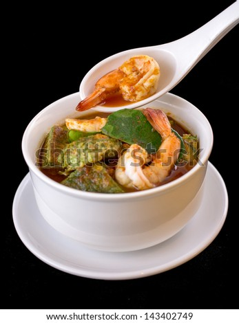 Thai spicy soup with  shrimp on black background