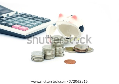 Thai stack coins with broken piggy bank and calculater on white background, financial concept photo