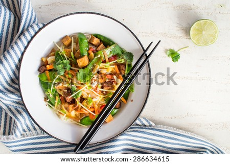 Thai stir fry with tofu, coriander and snow pea - stock photo