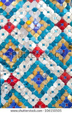 Thai style ancient ceramic tile in Royal palace, Bangkok, Thailand. - stock photo