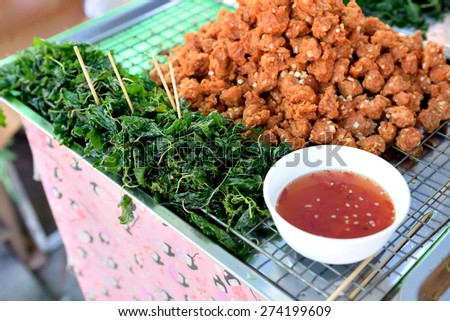 Thai style appetizer of fried tempura asparagus with dipping sauce.  - stock photo