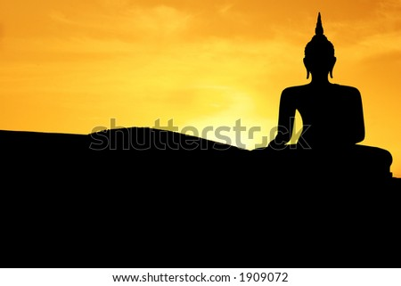 Thai style buddha at sunset