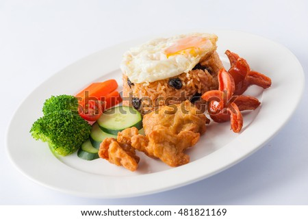 Thai style cuisine fried rice with raisin deep fried chicken, sausage ...