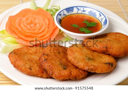 Thai style deep fried chicken cakes on white background