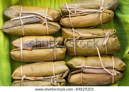 Thai style dessert, made from banana and glutinous rice, wrap with banana leaf