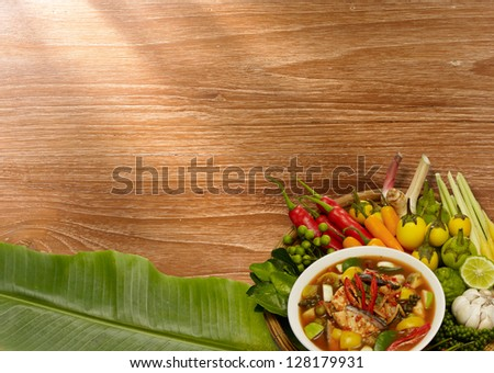 Thai style food Red curry cook with Asian Redtail Catfish and herb. - stock photo