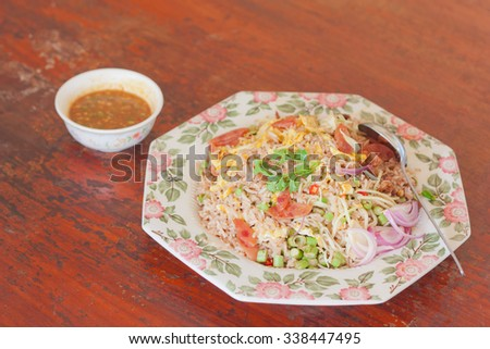 Thai style fried rice mixed with shrimp paste - stock photo