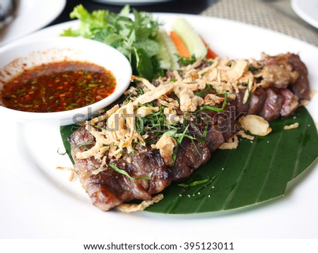 Thai Style Grilled Beef Steak with Spicy Sauce - stock photo