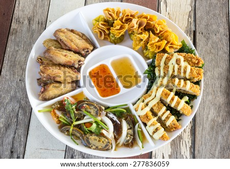 Thai-style Hors d'oeuvres on white dish - stock photo