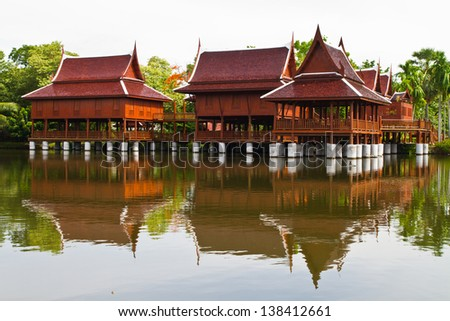 Thai style house and reflection in the water