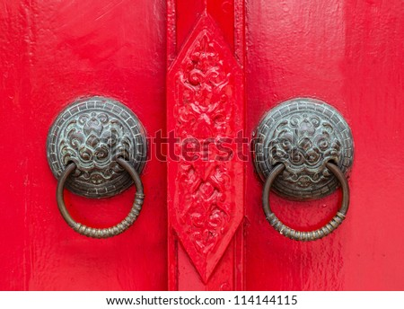 Thai style lion door knob background - stock photo