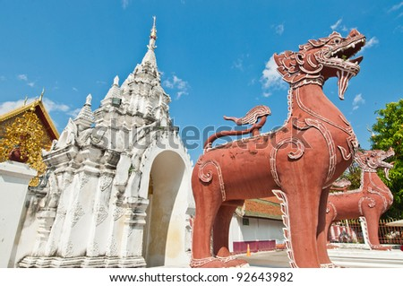 Thai style lion statue with blue sky, Thailand.