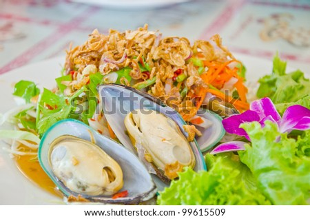 Thai style new zealand sea mussel salad in restaurant, Thailand - stock photo