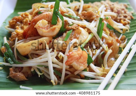 Thai style noodles or Padthai on the banana leaf - stock photo