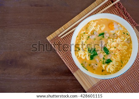 Thai Style Noodles with chopstick top View on wood table - stock photo