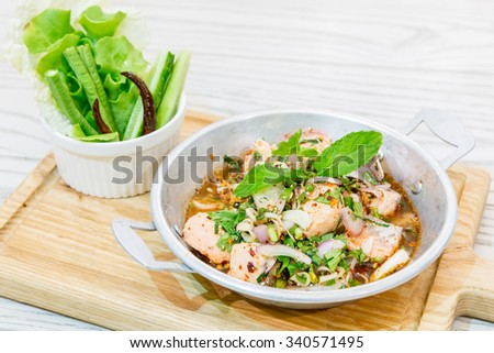 Thai Style Spicy Salmon salad with fresh vegetable