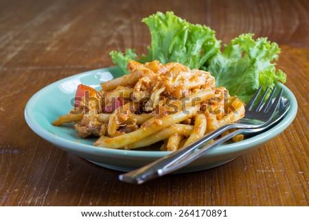 Thai style stir fry Macaroni with egg, pork and vegetable in tomato sauce  - stock photo