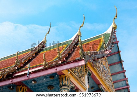 Thai style temple roof with blue sky background