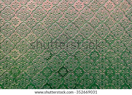 Thai style wooden carving texture  vintage color tone with filter color effect. - stock photo
