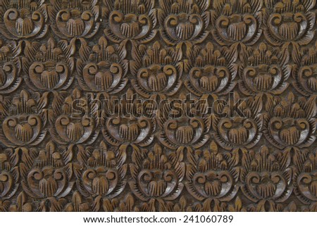 Thai style wooden craft on antique furniture. - stock photo