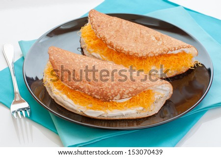 "Thai sweet pancakes, or ""Khanom Thangtaek""?� is traditional Thai sweets both flavor and taste. It offers the original flavors including sweet, good smell as well as the unique appearance. - stock photo"