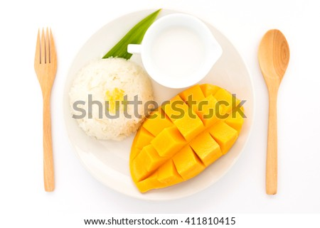 Thai sweet sticky rice with mango. Thai style tropical dessert, glutinous rice eat with mango - stock photo