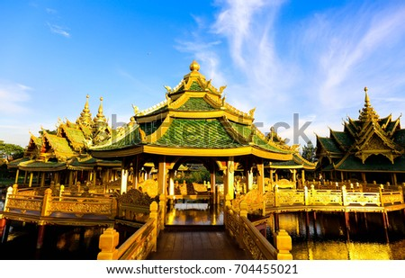 Thai temple riverside with blue sky