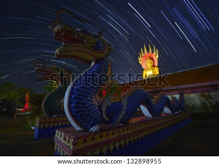 thai temple with star trail scene