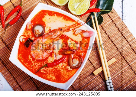 Thai Tom Yam soup with shrimp and shiitake mushrooms, served with lime - stock photo