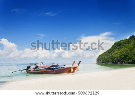 Thai traditional boats on Railay Beach, Krabi province, Thailand.