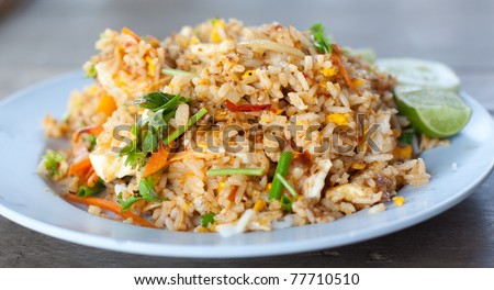 Thai traditional fired rice with lemon and vegetable as fast food.
