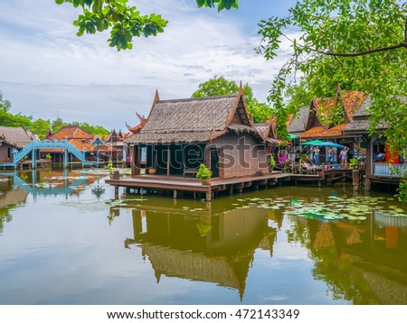 Thai traditional houses style along canal, Ancient City, Samutprakan, Thailand