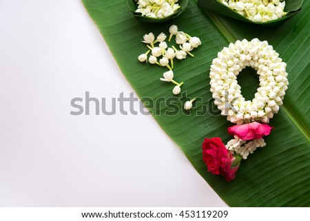 Thai traditional jasmine garland.symbol of Mother's day in thailand on Banana leaf. - stock photo