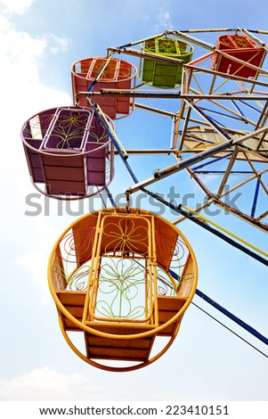 Thai traditional retro ferris wheel on blue sky - stock photo