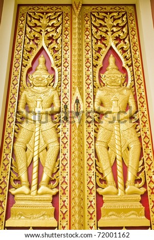 Thai traditional style door painting, coated with real gold plate.