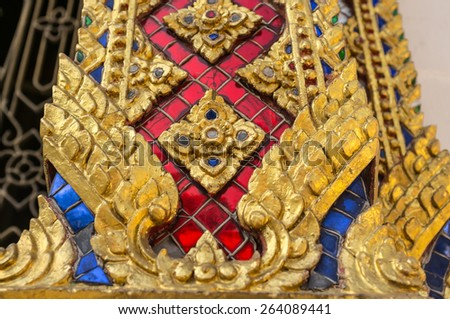 Thai traditional wall sculpture in buddhist temple - stock photo