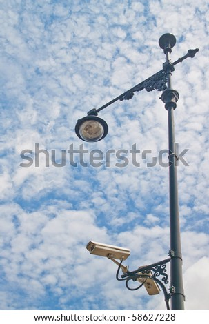 Thai vintage lamp with security camera in a blue sky day
