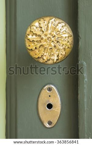 Thai vintage style olden door knob with key hole - stock photo