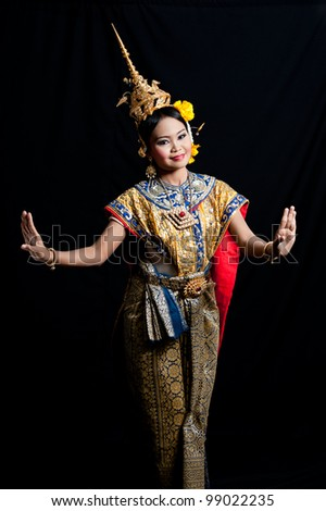 Thai woman classical dancer on black background - stock photo