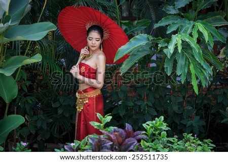 Thai Woman In Traditional Costume Of Thailand - stock photo